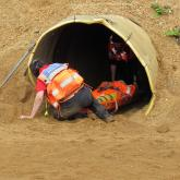 Team members removing Chris from the surge tunnel