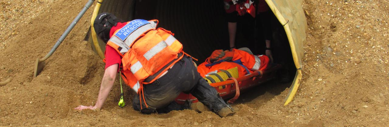 In safe hands... a 'casualty' is rescued from the enclosed space at Needingworth quarry.